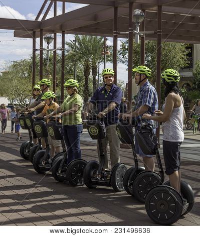Scottsdale, Arizona Usa - March 11, 2018: Tourists With Guide On Segway Scooters Touring Downtown Sc