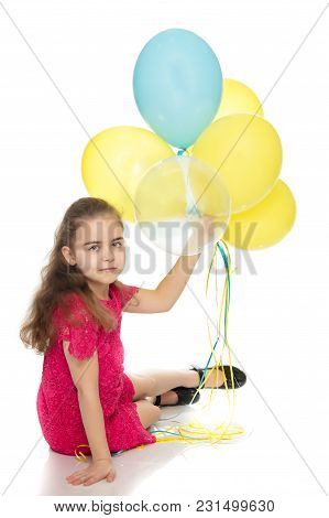 Little Girl Is Playing With A Balloon. The Concept Of The Holiday, Birthday. Isolated Over White Bac