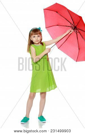 A Little Girl With Long Blond Hair And A Short Bangs, In A Short Summer Dress.the Girl Closed From T