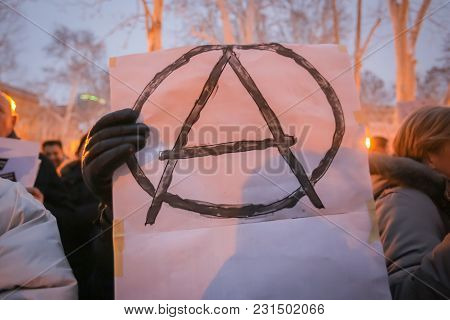 Zagreb, Croatia - 3rd March, 2018 : Woman Holds An Anarchy Sign On Protest Against The Financial Enf