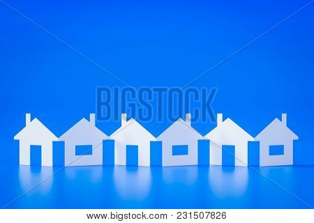 3d illustration of a paper cutout row of houses blue background