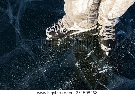 Ice Skater Skates Covered With Snow On The Picturesque Ice Of Lake Baikal In Winter During A Bright