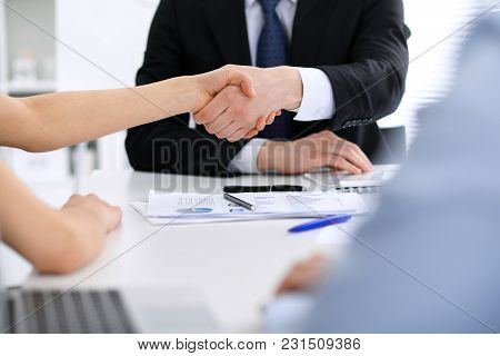 Close Up Of Unknown Business People Shaking Hands While Finishing Up A Meeting. Handshaking, Agreeme