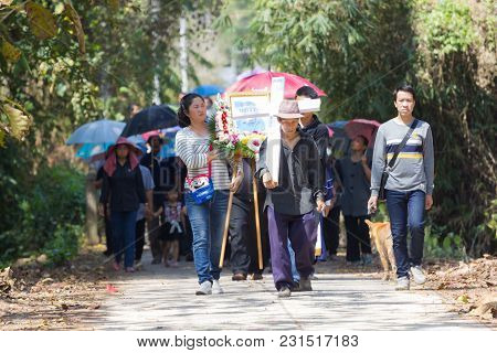 Chiangrai, Thailand - February 24: Unidentified Crowd People Walking On The Road Heading To The Grav