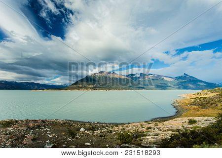 Beautifu Blue Green Lake On Cloudy Day, Patagonia, Intense Clouds