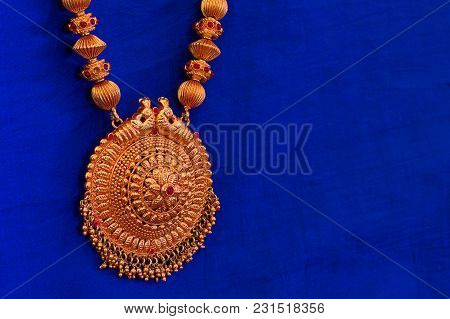 Close View Of A Golden Necklace, Pune