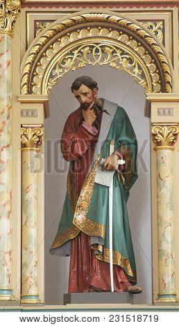 SISAK, CROATIA - DECEMBER 07: Statue of Saint Paul on the main altar in the Church of Holy Cross in Sisak, Croatia, on December 07, 2017.