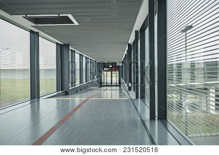 Interior Of Elevated Pedestrian Tunnel In Airport