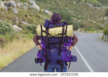 Digital composite of traveler on the road
