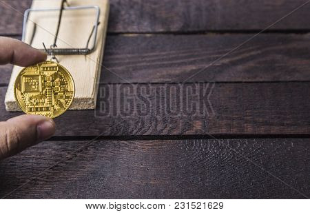 Wooden Mouse Trap And Man Holds Backside Of Bitcoin