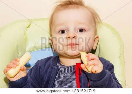 Little Baby Boy Holding Delicious Corn Snacks, Concept Of Dessert For Kids