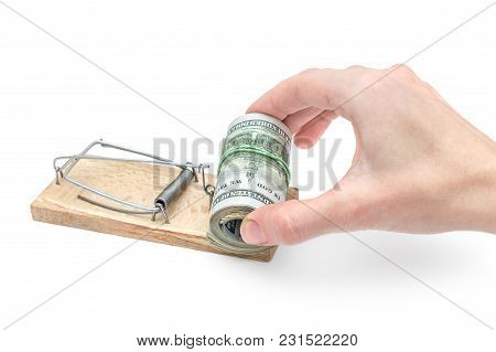 Female Hand Takes Money From Trap On White Background. Business Concept.