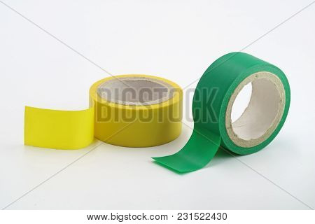 Yellow And Green Insulating Tapes Are Isolated On A White Background.