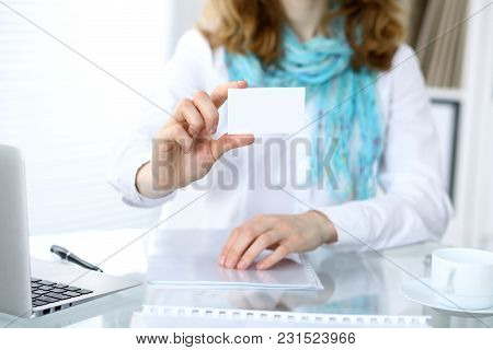Close-up Of Business Woman Giving A Visit Card.