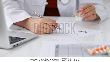 Female Medicine Doctor Fills Up Prescription Form To Patient Closeup. Panacea And Life Save, Prescri