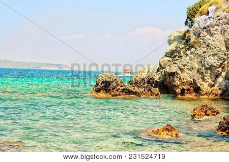 Seascape On Rock Bright Day Blue Water