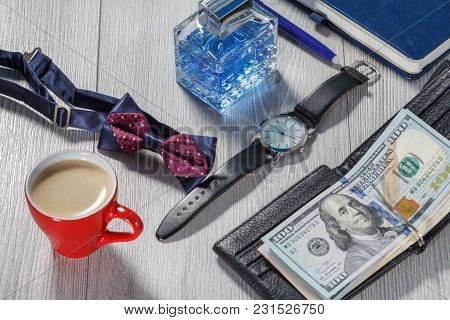 Man Perfume, Watch With A Black Leather Strap, Bow Tie, Cup Of Coffee, Notebook And Black Leather Wa