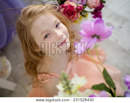 The Beautiful Face Of A Redheaded Child Is 9 Years Old In Freckles In Flowers. Spring