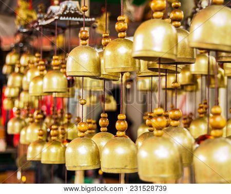 Many Brass Bells Hanging On The Rope In The Shop , Selective Focus Bell