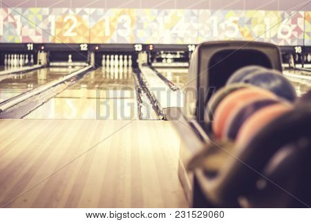 Blurred Image Of Bowling Ball On The Mechine. Blur And Retro Look Background