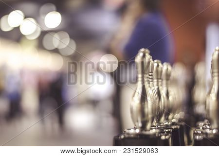 Blurred Image Of Bowling Trophy. Blur Background And Bokeh Effect