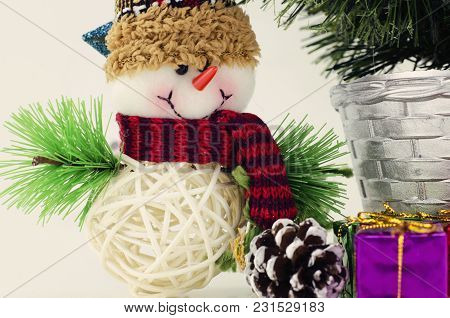 Horizontal View Closeup Image Of Santa Claus, Purple Gift Box, And Christmas Tree Isolated On White