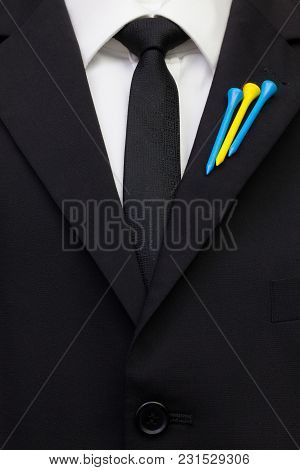The Detail Of Wedding Suit With Golf Design.golf Tees In The Color Of The Swedish  Flag On The Flap