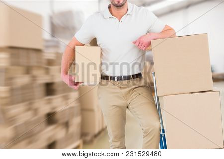 Digital composite of delivery man in warehouse