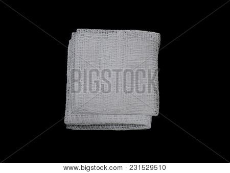 Isolated Gauze Pads On The Black Background , First Aid Accessories.