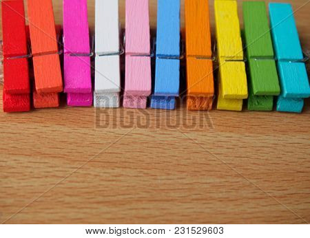 Blur Background - Row Of Colorful Wooden Pegs On Wooden Table