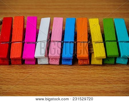 Blur Row Of Colorful Wooden Pegs On Wooden Table