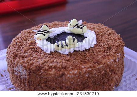 Pictured In The Photo Delicious Chocolate Cake With Creamy Bees.