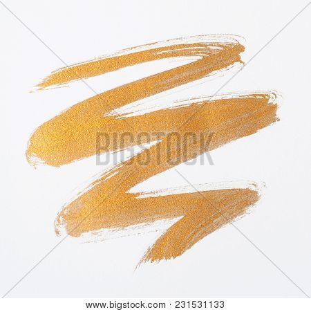 Gold Paint Smear Stroke Stain Over White Background