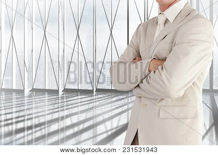 Digital composite of business man in office