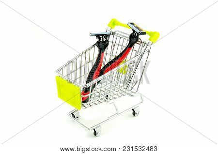 Two Brand New Red And Black Color Disposable Shaver In Shopping Trolley Isolated On White Background