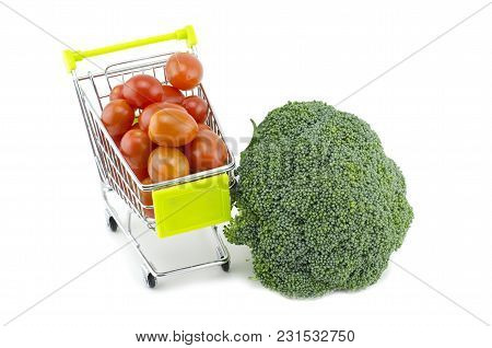 Fresh Green Broccoli, Cherry Tomatoes On Trolley Isolated On White Background
