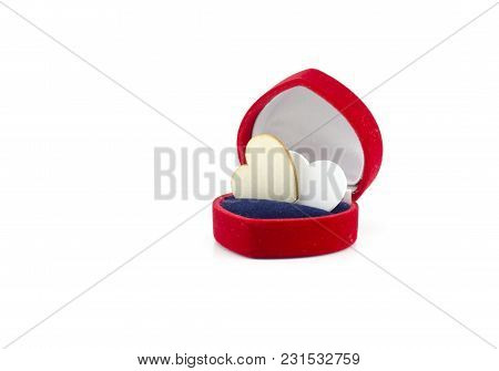 Heart Symbol Made From Wood In Red Ring Case Isolated White Background. Empty Space To The Left