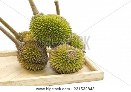 Group Of Durian On Plain Wood,king Of Fruits Isolated On White Background