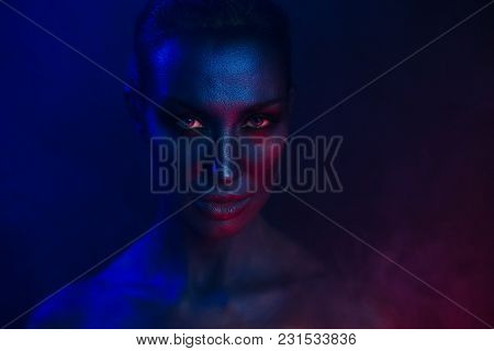 Female Art Portrait. Beautiful Sexy Young Woman With Glamorous Mystical Makeup In Nightclub. Beautif