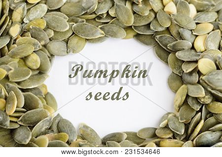 Pumpkin Seed In Glass Bowl On White Table. Superfood Pumpkin Seeds  Background. Healthy Eating  And