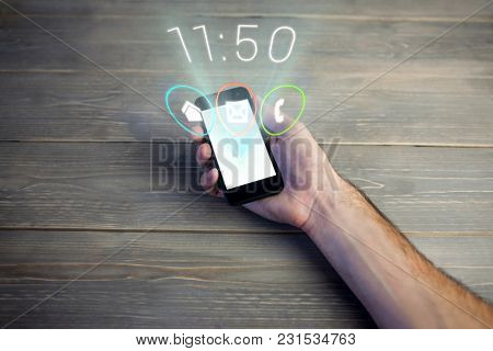 Digital composite of hand with phone with futuristic interface