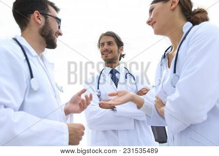Group of medicine doctors talking during conference, bottom view
