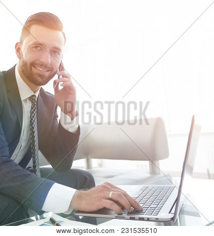 foreground businessman talking on a smartphone