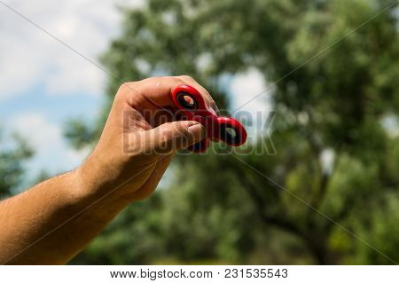 Man Playing With Fidget Spinner Stress Relieving Toy Outdoor