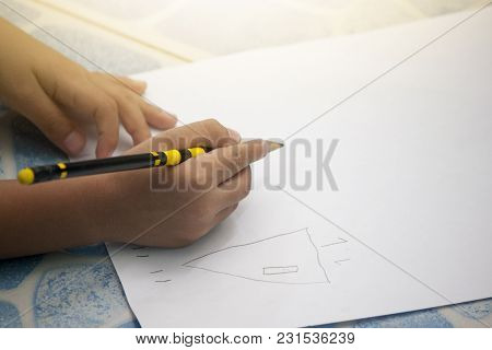Children Write A Book On White Paper Draw Basic Cartoon.