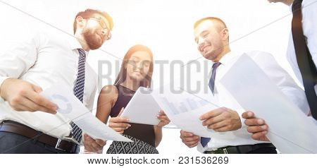 closeup of business team discussing work documents