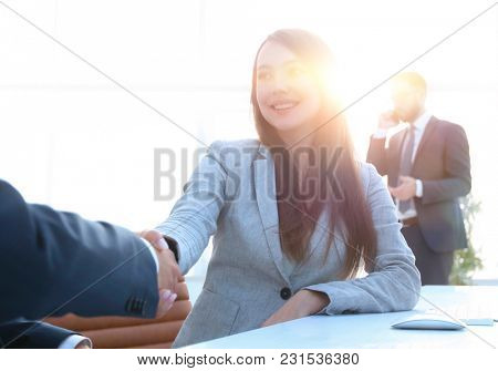 female consultant greeting the customer .