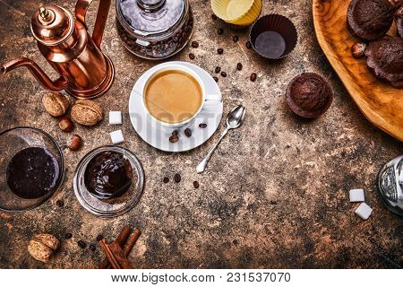 Crafting coffee in cup with bean cezve and chocolate cake top view on grunge background.