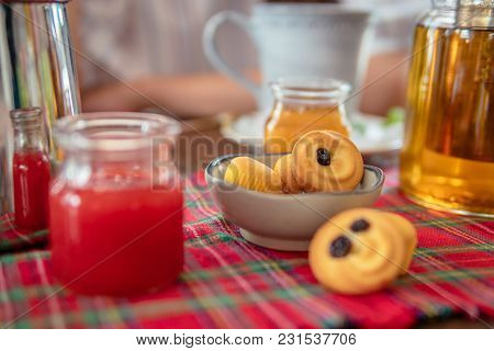 Tea Drinking With Cookies And Muffins And Jam