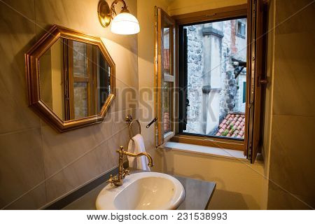 Small Bathroom With Mirror And Sink And Window